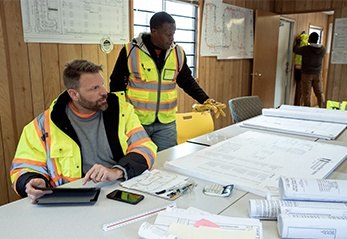 Construction workers sitting at a table