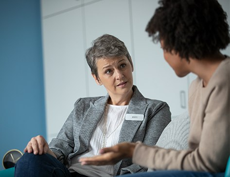 Female mental health professional speaking to a female patient