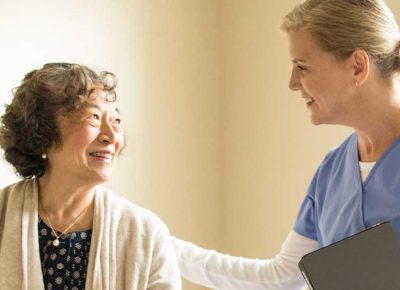 Healthcare worker smiling at patient